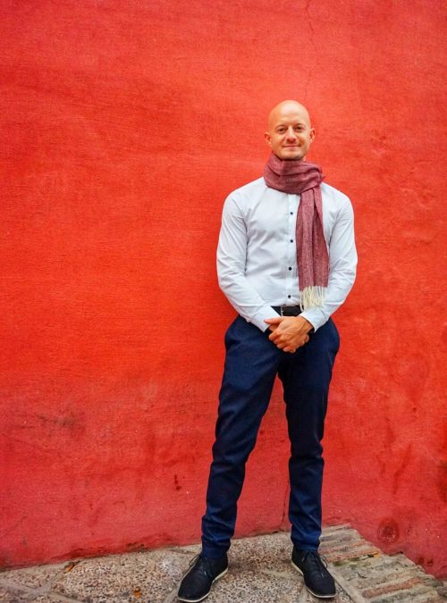 social media manager, against red wall